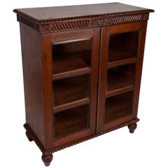 British Colonial Mahogany Petite Bookcase with Glass Door Panels, Early 1900s