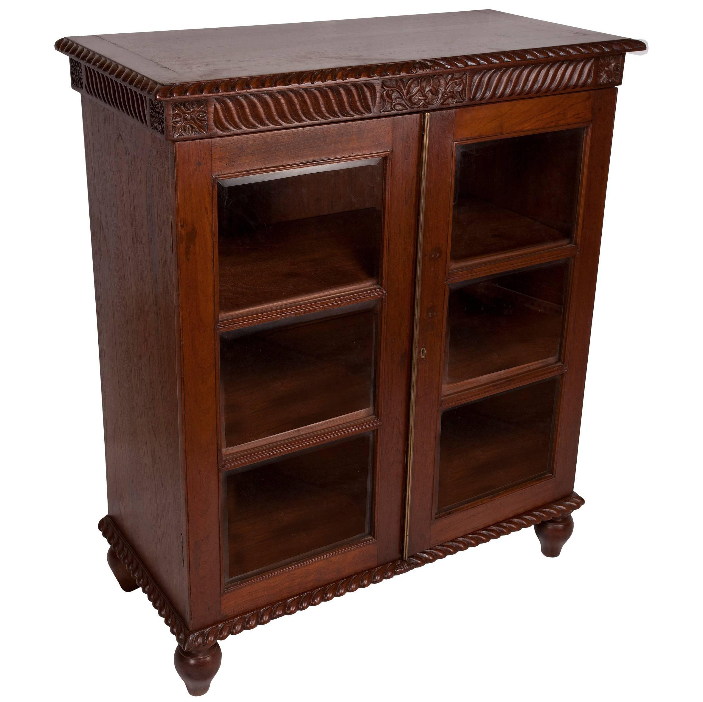 british colonial mahogany petite bookcase with glass door panels early 1900s