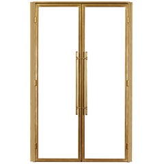 Clean Modern Bronze Doors with Machined Bronze Door Pulls and Hinges