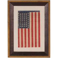 44 Tumbling Stars in an Hour Glass Formation, on an Antique American Parade Flag
