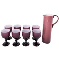 Set of Eight Purple Glass Wine Goblets with Pitcher