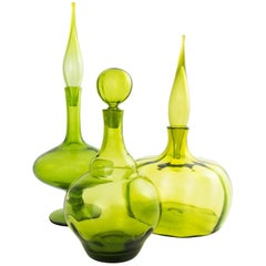 Collection of Three Olive Green Blown Glass Decanters