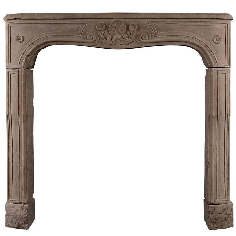 Carved Louis XV Limestone Fireplace