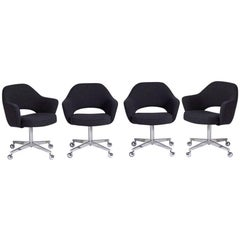 Four Rolling Reupholstered Saarinen Executive Chairs for Knoll, circa 1960s