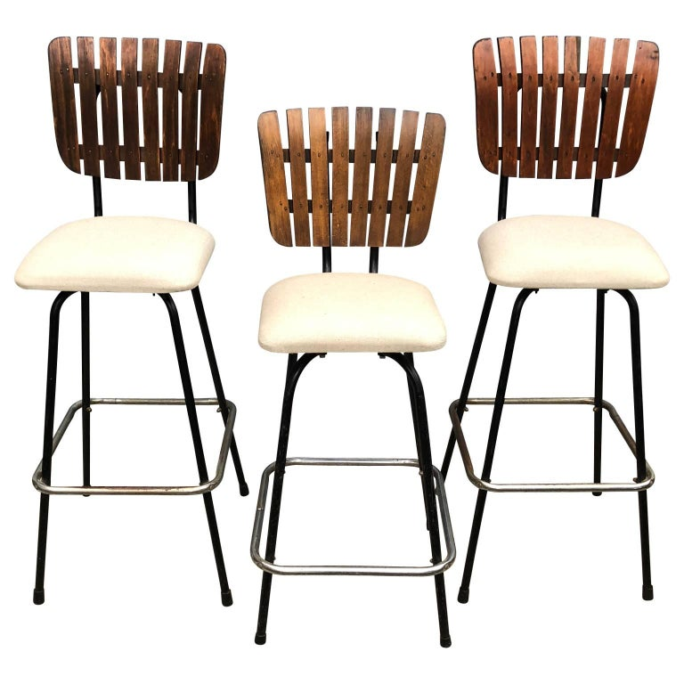 Three Arthur Umanoff Style Upholstered and Wood Bar Stools