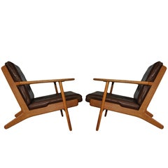 Pair of Hans J Wegner ge290 Oak Lounge Chairs, 1950s. Restored.
