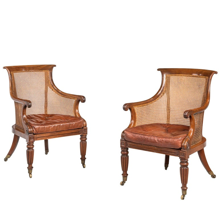 Pair of Regency Period Bergère Library Chairs with Swept Arms