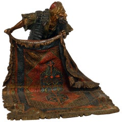 Good Bergman Bronze of a Arab Carpet Dealer Showing His Wares