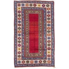 Impressive Antique Caucasian Kazak Rug with Solid Red Ground