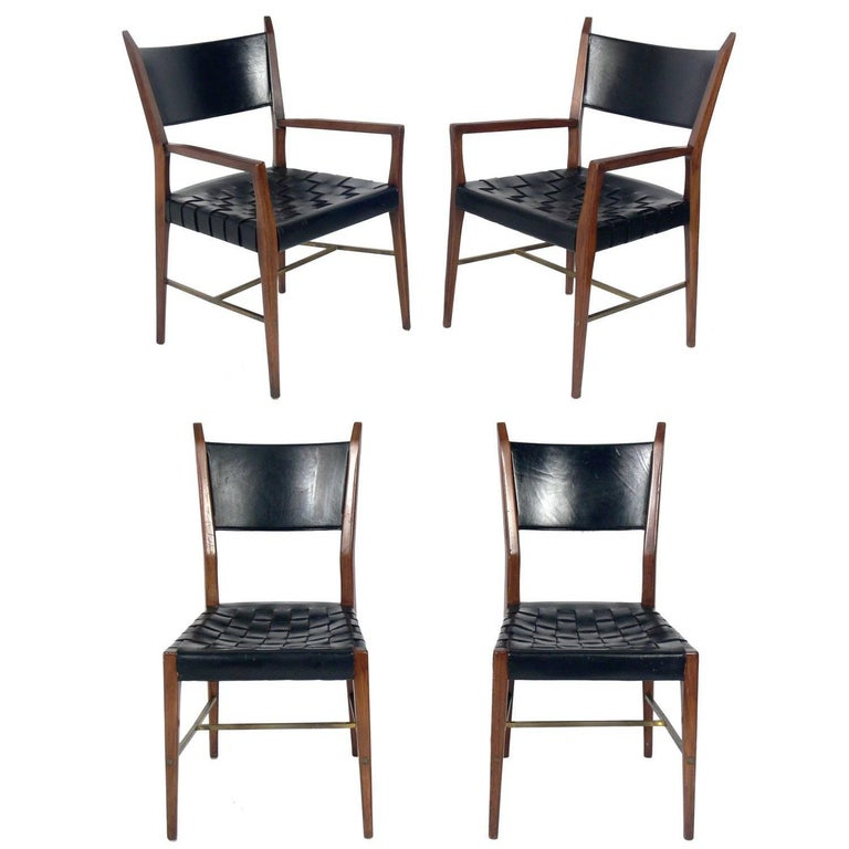 Set of Four Black Leather Walnut and Brass Dining Chairs by Paul McCobb