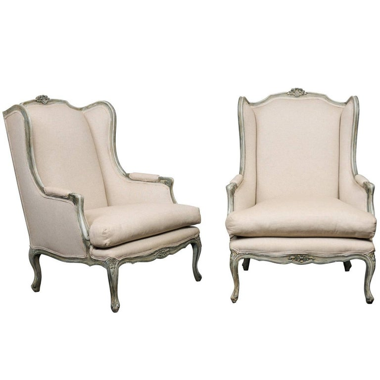 Pair of Mid-20th Century French Carved Wood and Upholstered Wingback Chairs