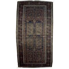 Handmade Antique Distressed Afghan Baluch Oriental Rug, 1900s