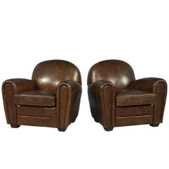 Pair of Compact Distressed Brown Leather Club Chairs