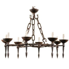 Vintage Round Iron Chandelier with Eight Torch Style Lights and Scroll Pattern