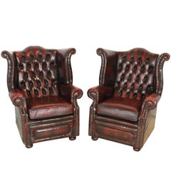 Set of Two English Chesterfield Wingback Oxblood Leather Chairs, circa 1930