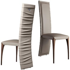 """Il Pezzo 7 Chair"" comfortable dining chair surrounded of sinuous leather folds"