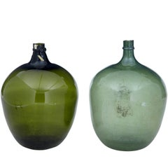 Two Large Green Glass Distillery Bottles