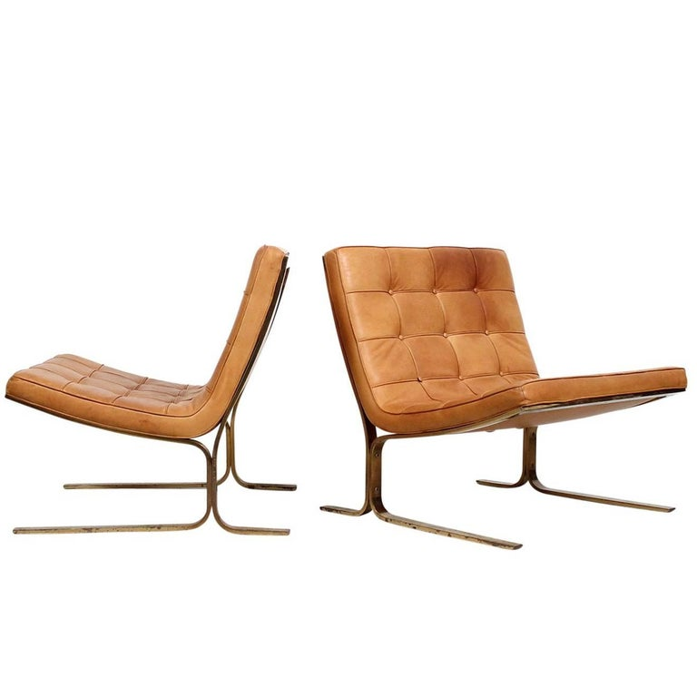 Pair of Leather Lounge Chairs by Nicos Zographos For Sale