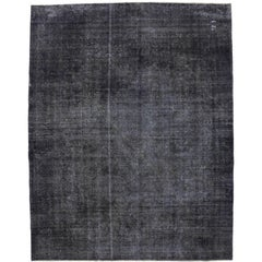 Distressed Antique Persian Charcoal Overdyed Rug with Modern Industrial Style