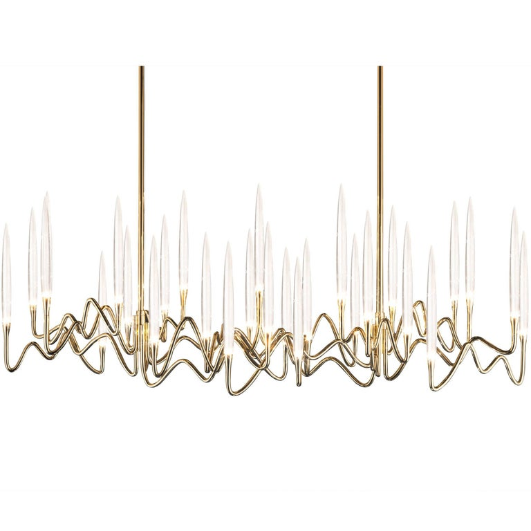 """Il Pezzo 3 Long Chandelier"" with a hand forged gold brass structure and crystal"