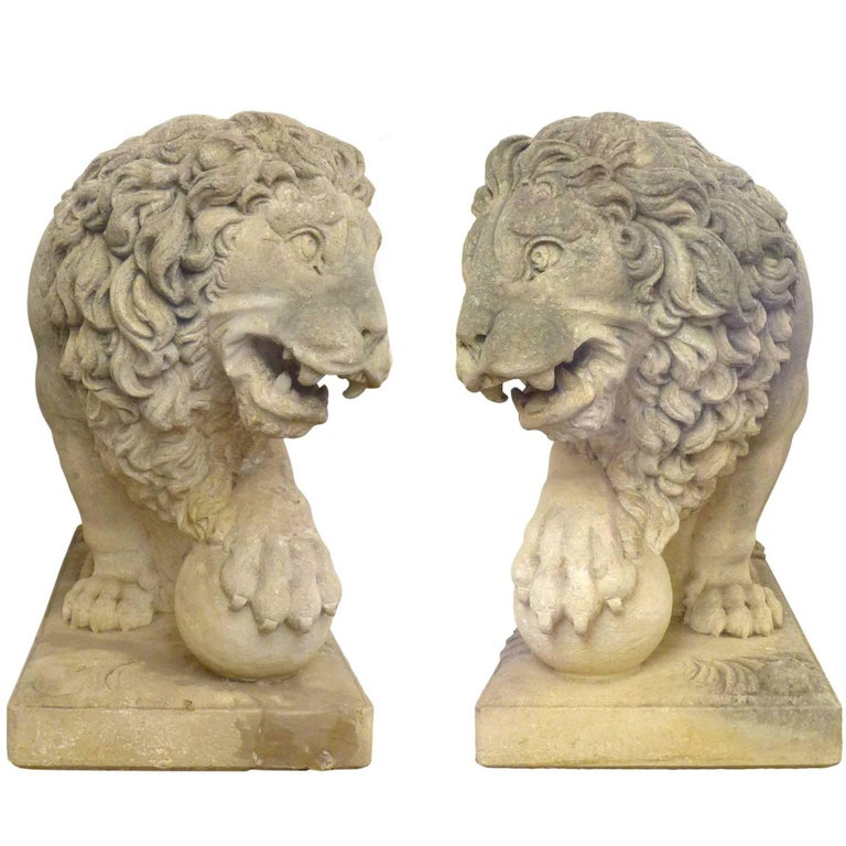 A fantastic pair of Italian, life-sized, carved-limestone, lion statues. Monumental works in the neoclassical style with masterful, expressive detail throughout: thick, flowing manes; exposed ribs and flexed musculature; powerful paws and fierce
