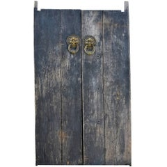 Rustic Antique Doors with Brass Knockers
