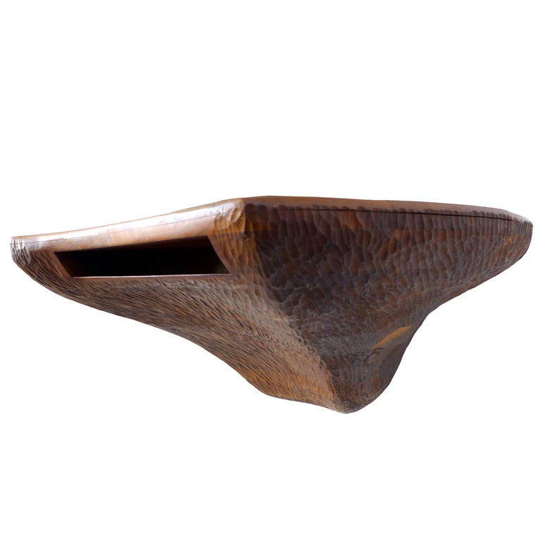 A very unusual and sculptural American craft, chip-carved and stack-laminated wood console. This hand-crafted, wall mount piece is a dramatic, artful and functional furniture statement. It's organically asymmetrical form and storage cut-out make for