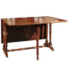 19th Century Walnut French Gateleg Table, circa 1890