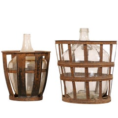 Pair of French Mid-20th Century Vintner Iron Baskets with Demijohn Wine Bottles