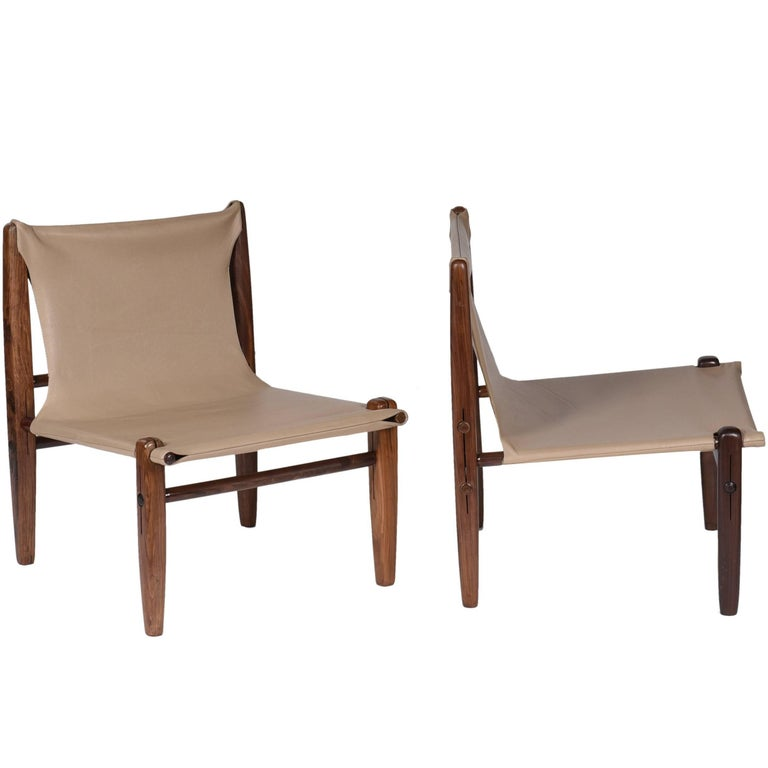 Midcentury Brazilian Armchair in Rosewood and Leather by unknown author, 1960s  This interesting armchair, still anonymous, is all built in solid rosewood without the use of screws or nails, and is completely removable. Its leather seat fits firmly