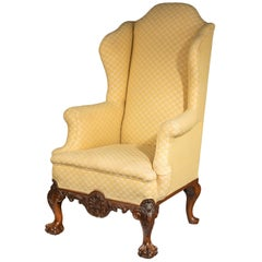 Queen Anne Style Irish Mahogany Framed Wing Chair Terminating in Paw Feet