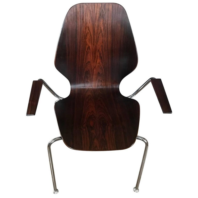 Mid-century Danish rosewood chair.  Danish armchair in chrome and rosewood in mint vintage condition.  Denmark, circa 1960's   Dimensions: 23