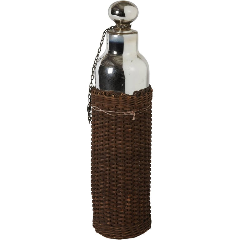 Vintage Wicker Mercury Glass Thermos Bottle For Sale