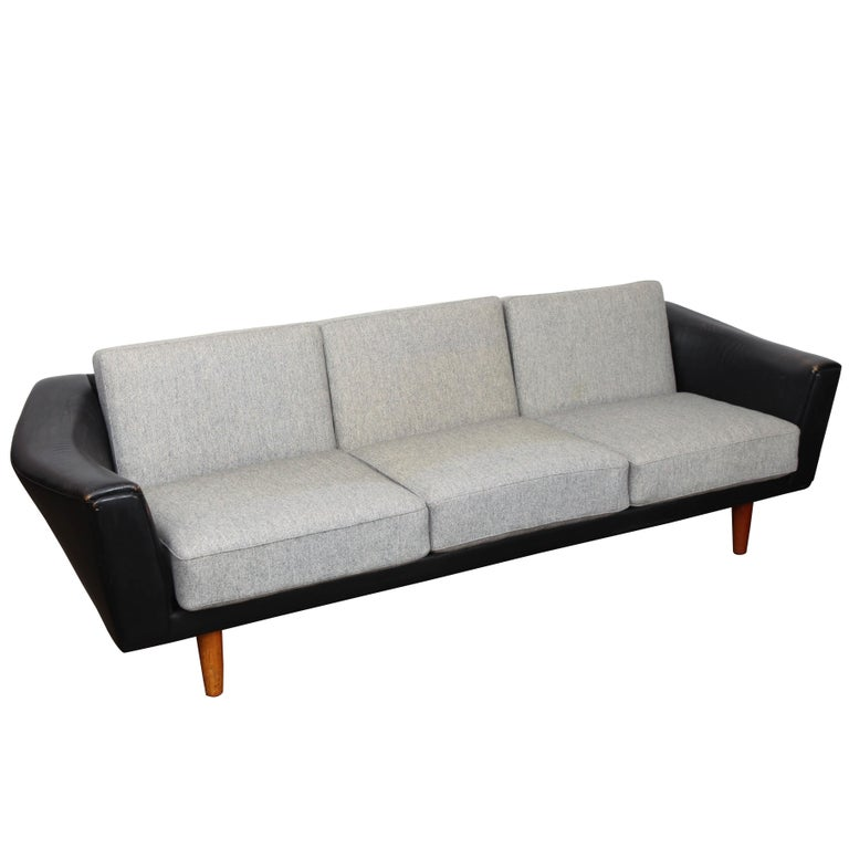 Danish Mid-Century Modern Black Leather Tuxedo Sofa by Illum Wikkelso For Sale