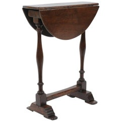 English 1870s Petite Turned Oak Drop-Leaf, Round Top Table with Trestle Base