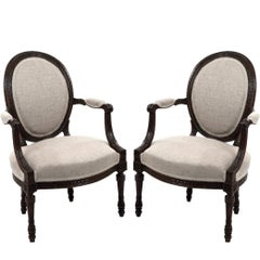 Pair of French Louis XVI Oval Back Upholstered Armchairs