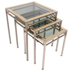 Extractable coffee tables in metal and brass smoked glass: Italy 1970s