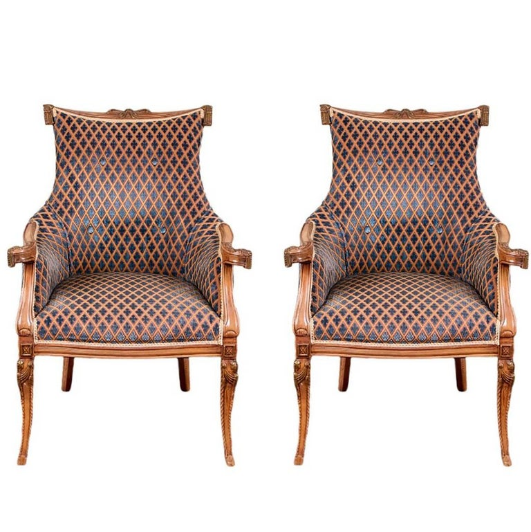 Pair of Hollywood Regency Carved Fireside Chairs For Sale