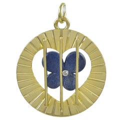 "Unusuall ""Prisoner of Love"" Gold & Lapis Charm"