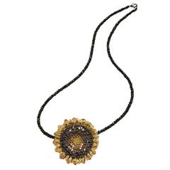Sunflower Pendant/Pin on black spinel strand by Alex Soldier. Handmade in NYC.