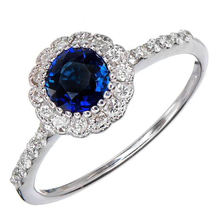 royal blue sapphire halo gold engagement ring for