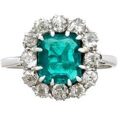 1910s Antique 1.62 Carat Emerald and Diamond Platinum Cluster Ring