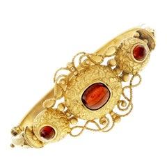 Garnet Cabochon Gold Bangle Bracelet