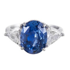 7.02 Carat Oval Sapphire Trillion Diamond Platinum Ring