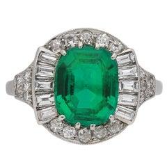Art Deco emerald and diamond cluster ring, circa 1925.