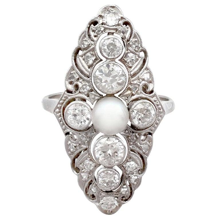 1940s Pearl and 1.70 Carat Diamond Platinum Cocktail Ring