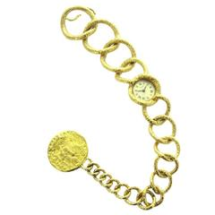 An Early 70's Salvador Dali Yellow Gold Bracelet Watch with Coin by Piaget