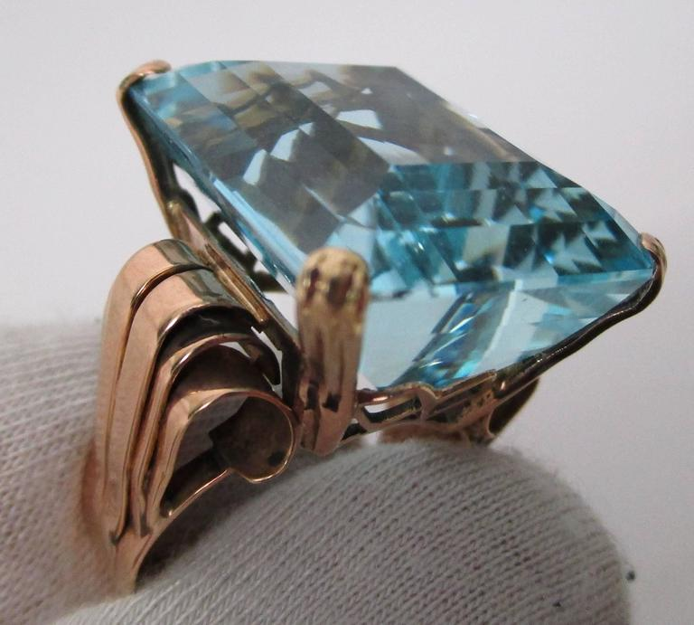 This ring is absolutely dazzling! This lovely Aquamarine is old material, probably old Santa Maria mine (Brazil). The color is Brazil Blue, not Gray like African aqua blue color. This stone was recut for our store by an AGTA 7-time Spectrum Award