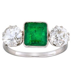 A Mid 20th Century Emerald And Diamond Three-stone Ring
