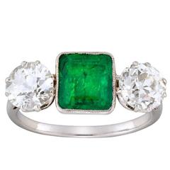 Edwardian Emerald Cut Emerald Diamond Three Stone Platinum Ring